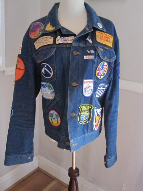 Great wrangler denim jacket. A mans jacket with various badges of